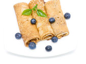 Pancakes and fresh blueberries on a white background — Stock Photo