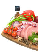Vegetables and raw meat on a cutting board on a white background — Stock Photo