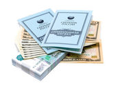 Two savings books lie on a stack of money on white background — Stock Photo