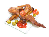 Smoked chicken wings close-up on a white background — Stock Photo