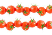 Cherry tomatoes on a white background — Stock Photo