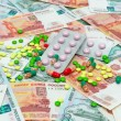 Medical drugs on the background of banknotes — Stock Photo