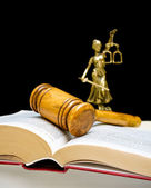 Gavel on law book on a black background. vertical photo. — Stock Photo