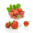 Fresh strawberries in a glass bowl on a white background — Stock Photo