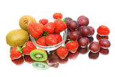 Ripe Berries and fruits on a white background with reflection — Stock Photo