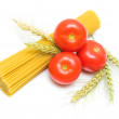 Spaghetti and ripe tomatoes isolated on white background — Stock Photo