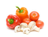 Mushrooms and vegetables on a white background close-up — Stock Photo