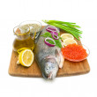 Fresh raw trout and caviar on a cutting board. white background. — Stockfoto #28548471