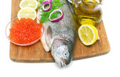 Fish trout, salmon roe, vegetables and spices on a white backgro — Stock Photo