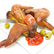 Smoked chicken wings on a plate on a white background close-up — Stock Photo