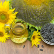 Stock Photo: Oil and sunflower seeds, sunflowers close up. horizontal photo.