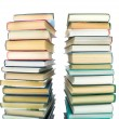 Stack of books on a white background with reflection — Stock Photo #28940795