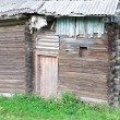 Old wooden house. Fragment. — Stock Photo #30544767