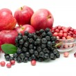 Bunch of black chokeberry, cranberry and apple close-up — Stock Photo