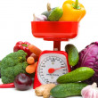 Kitchen scales and fresh ripe vegetables on white background — Stock Photo