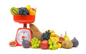 Fresh fruit and kitchen scales isolated on white background — Stock Photo