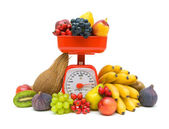 Kitchen scales and fresh fruit isolated on white background — Stock Photo