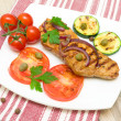 Stock Photo: Grilled meat with vegetables on a plate. horizontal photo.