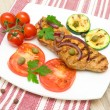 Grilled meat with vegetables on a plate. horizontal photo. — Stock Photo #31891351