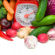 Kitchen scale and vegetables close-up — Stock Photo
