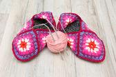 Wool socks and a ball of wool yarn with knitting needles close-u — Stock Photo