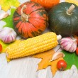 Autumn still life of vegetables and autumn maple leaves — Stock Photo