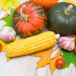 Autumn still life of vegetables and autumn maple leaves — Stock Photo #32202143