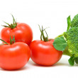 Ripe tomatoes and broccoli close-up. white background. — Stock Photo
