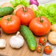 Stock Photo: Fresh vegetables on cutting board on wooden table close up
