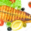 A piece of grilled salmon with vegetables and lemon on white bac — Stock Photo