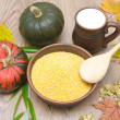 Corn grits, pumpkin and milk in a clay mug on a wooden table — Stock Photo