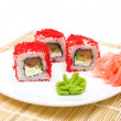 Rolls, pickled ginger and wasabi on a white plate — Stock Photo
