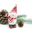 Toy snowman and pine cones on a white background close-up — Stockfoto