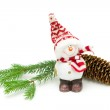 Toy snowman and fir-cone on a branch on a white background — Stockfoto
