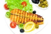 A piece of grilled fish with vegetables on the plate on a white — Stock Photo
