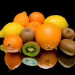Fruit on a black background with reflection — Stock Photo