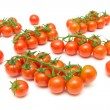 Bunch of ripe cherry tomatoes on a white background close-up. — Stock Photo
