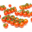 Bunch of ripe cherry tomatoes on a white background close-up. — 图库照片