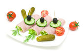 Rolls of ham with vegetables on the plate on white background — Stock Photo