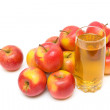 Apple juice in glass and ripe apples on a white background. — Stock Photo
