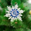 Stock Photo: Christmas toy on a Christmas tree closeup
