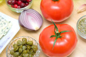 Tomatoes, capers and other foods closeup — Stockfoto