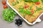 Lasagna, tomatoes, olives and salad Friese — Stock Photo