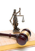 Statue of justice, gavel and book on white background — Stock Photo