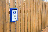 Mailbox hanging on a wooden fence — Stock Photo