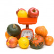 Fruits, vegetables and kitchen scale on white background — Stock Photo #38721203