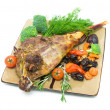 Roasted leg of lamb with vegetables and greens on a white backgr — Stock Photo