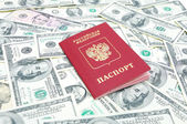 Russian passport on U.S. dollars background — Stock Photo