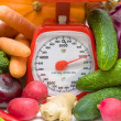 Kitchen scales and fresh vegetables — Stock Photo