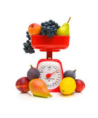 Fruit and kitchen scale on white background — Stock Photo